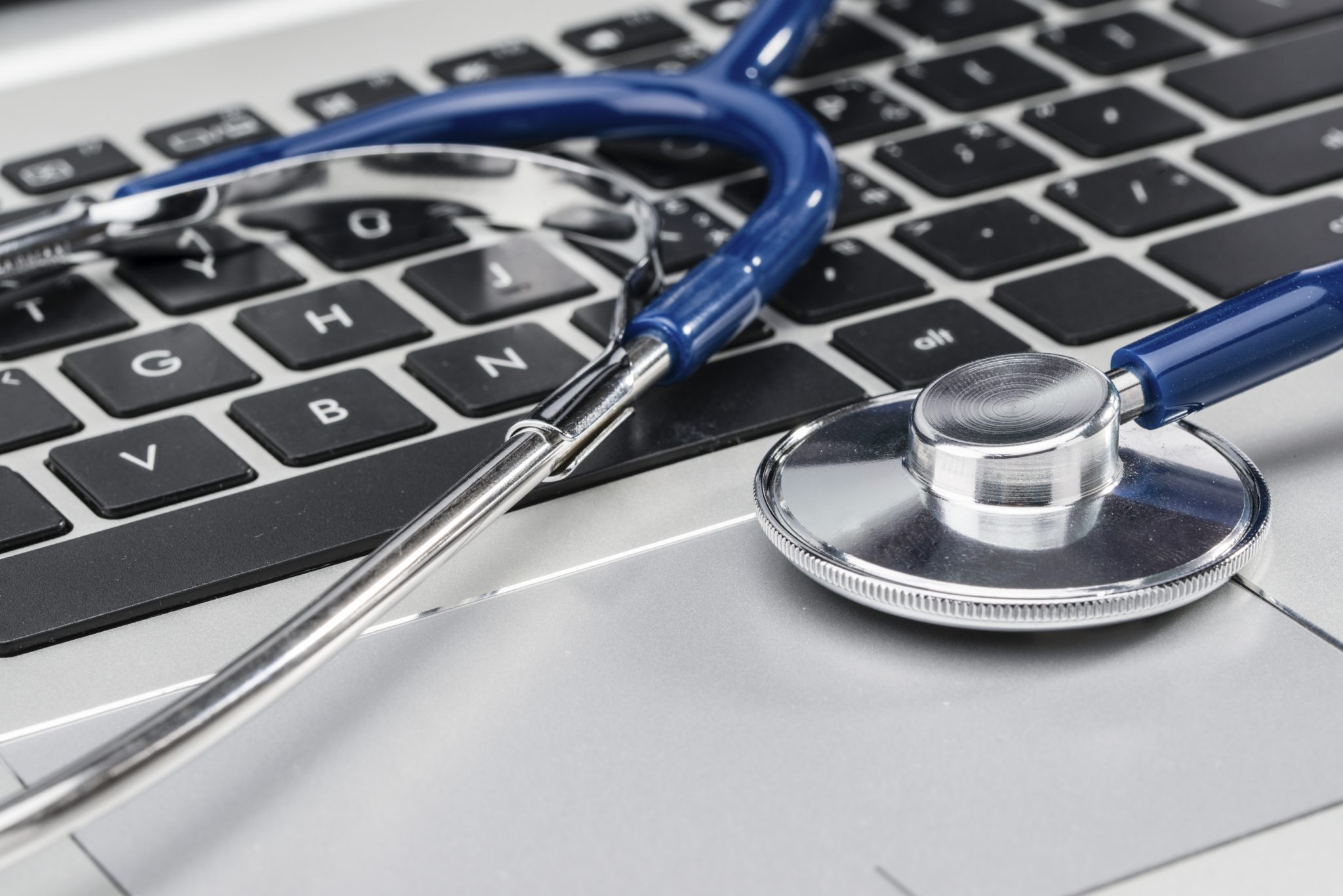 Medical Research, stethoscope on laptop keyboard, doctor workplace